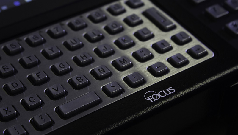 Close-up view of the Tempus Pro's metal weather resistant keyboard, with Focus logo