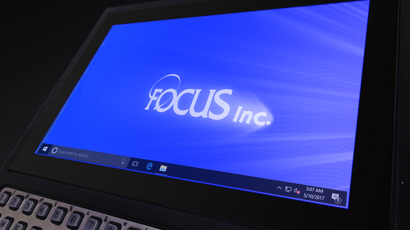 Close up of the Tempus Pro's screen, displaying Windows 10 with the Focus Inc logo